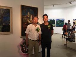 在融展览上与中央民族大学艺术学院教授刘秉江教授合影留念